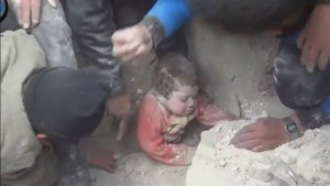 A child rescued alive, pulled from rubble in Syria.